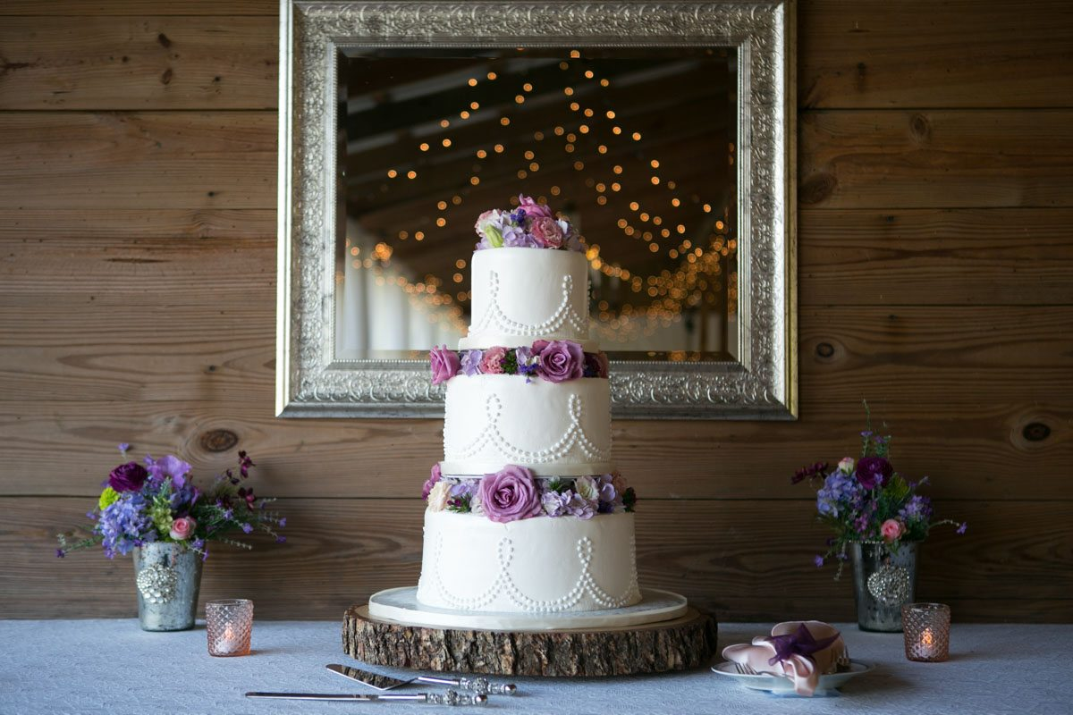 Cake close up with pink flowers and on wooden pedestal 4_1_16 Rocky and Evelyn Cross Creek Ranch Wedding 080