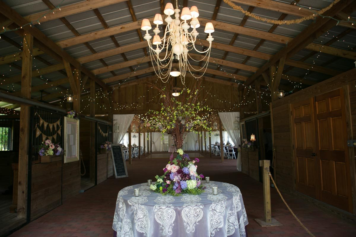 Welcome table featuring chandelier and purple lace linen 4_1_16 Rocky and Evelyn Cross Creek Ranch Wedding 003